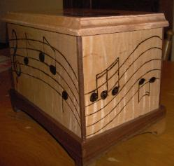 Musical notes wrap around box