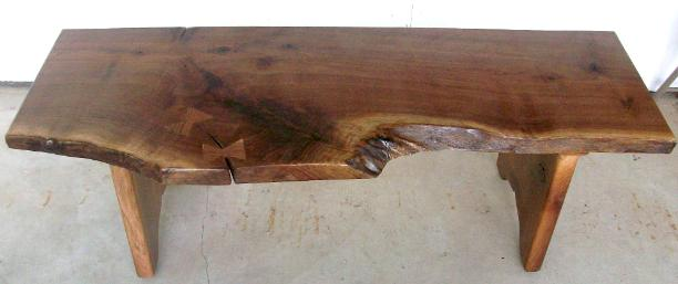 Rustic Walnut bench.  Made from one slab, live edge.  Koa wood butterfly keys to stabilize the crack.